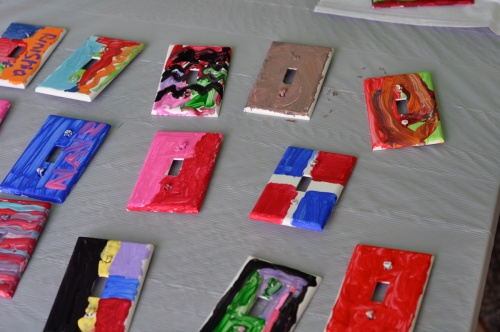 Some of the light switch plates on display as they dry. (Photo by Shelley M. Shockley)